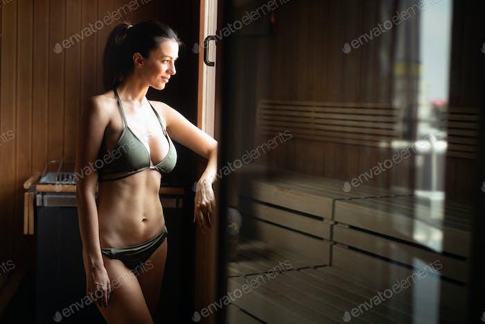 Woman enjoying sauna health benefits in spa