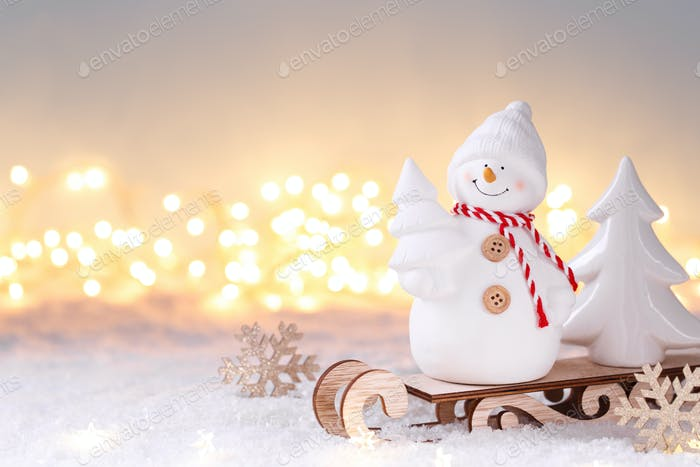 Snowman on the sledge