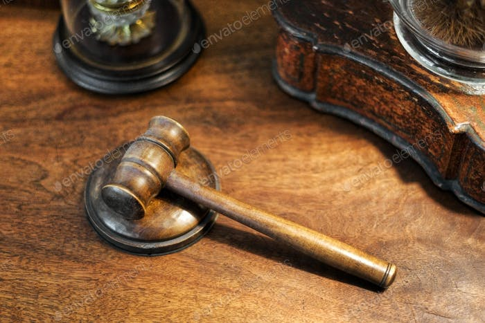 Small wooden judges gavel on a desk in a high angle view