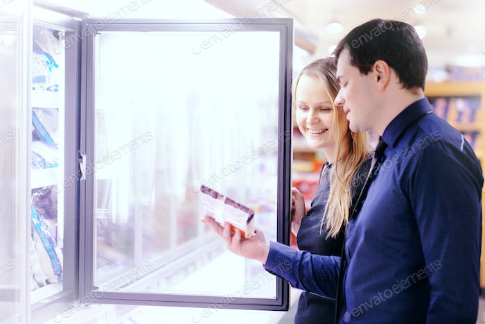 Couple in the frozen goods section