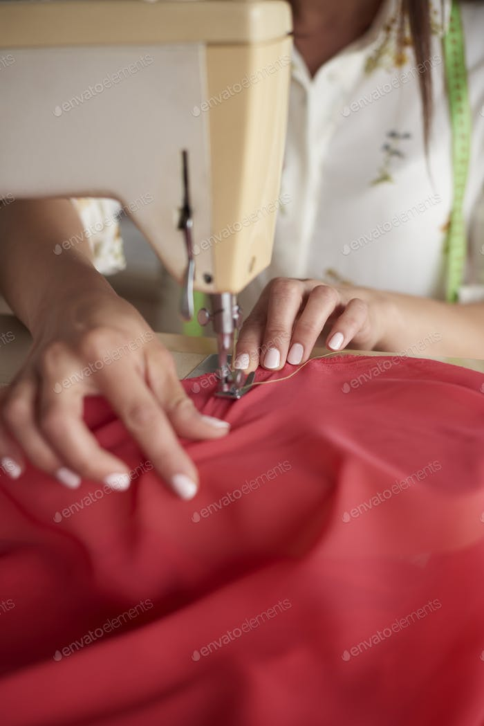 Tailor working at her workshop