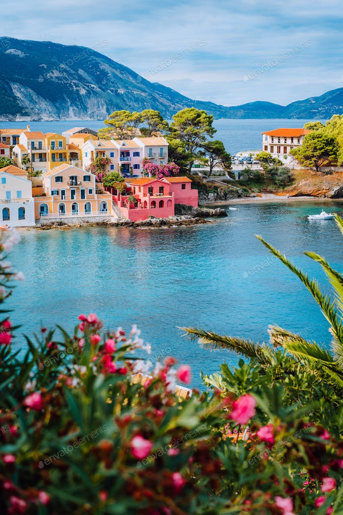 Beautiful view of Assos village with vivid colorful houses near blue turquoise colored and