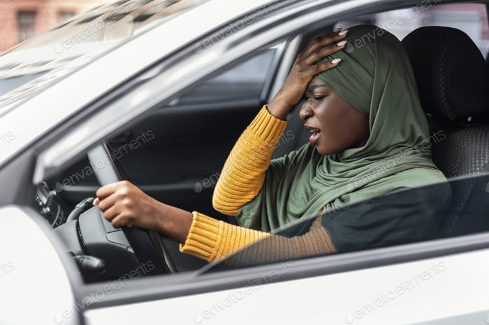 Driving Anxiety. Stressed Black Muslim Lady In Hijab Having Car Accident