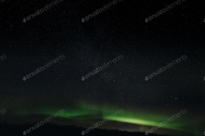 majestic view of night sky with aurora borealis and stars in iceland