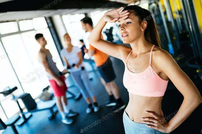 Close-up image of attractive fit woman in gym