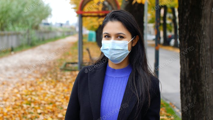 Young woman with surgical mask