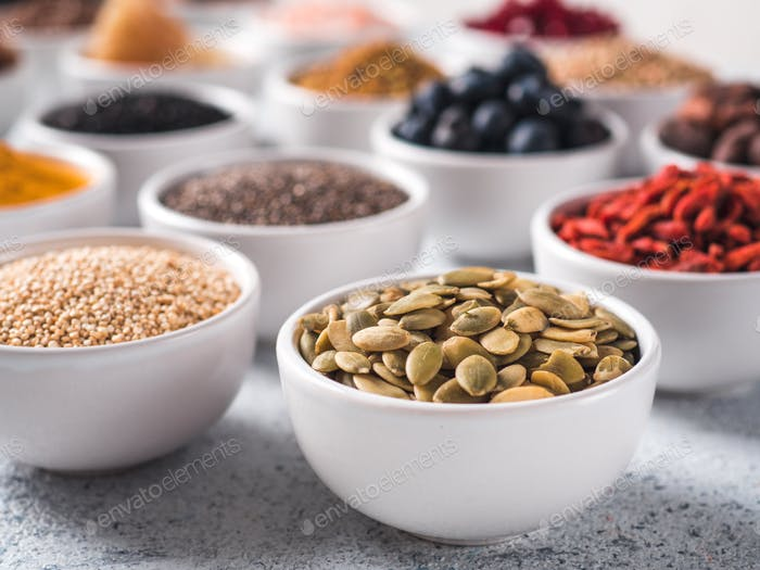 pepitas in small white bowl and other superfoods