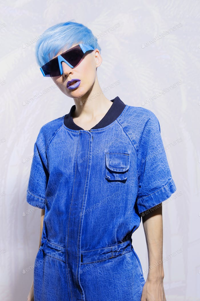 Fashion Model with blue short hair. Trendy colours hair style concept