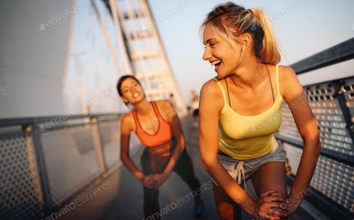 Fitness, sport, people, exercising and healthy lifestyle concept. Happy fit friends working out