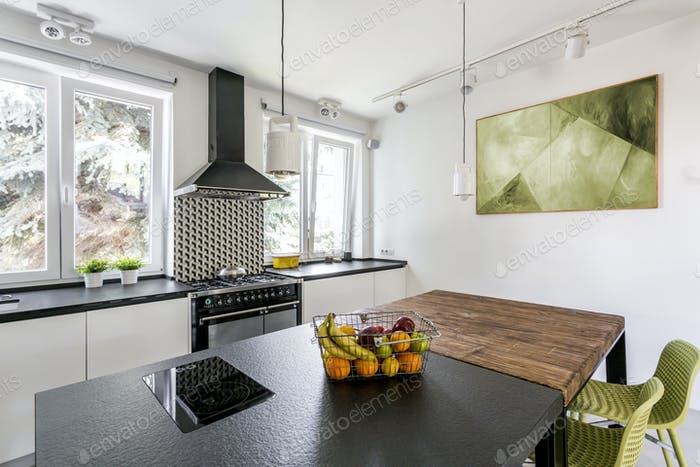 Two tables in bright kitchen