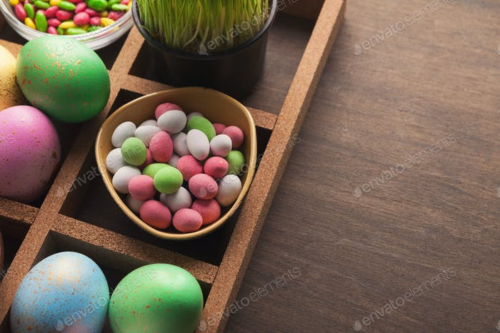 Bright colorful easter eggs on brown background