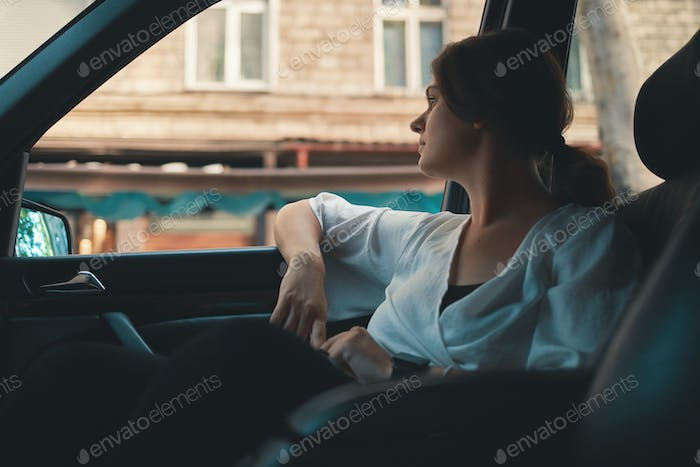Portrait young woman passenger, traveler watching city life