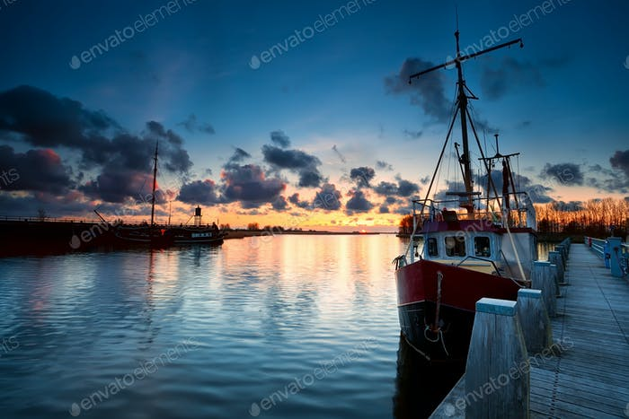 fishing ships at sunset in Zoutkamp