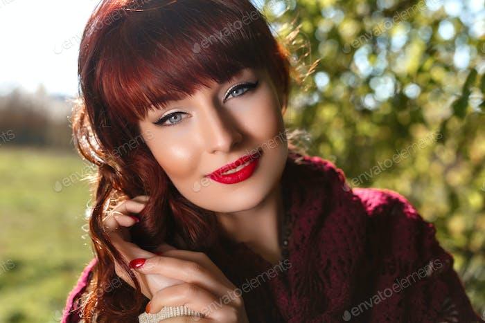 Beautiful girl outdoors in countryside