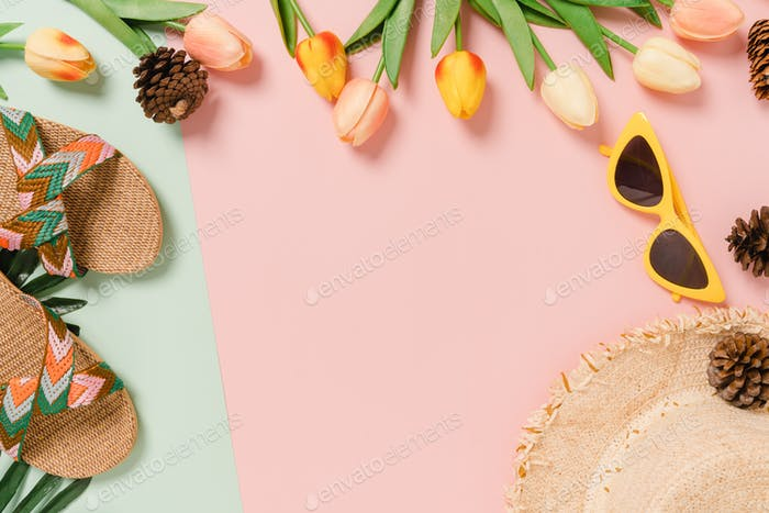 Creative flat lay of travel vacation spring or summer tropical fashion.