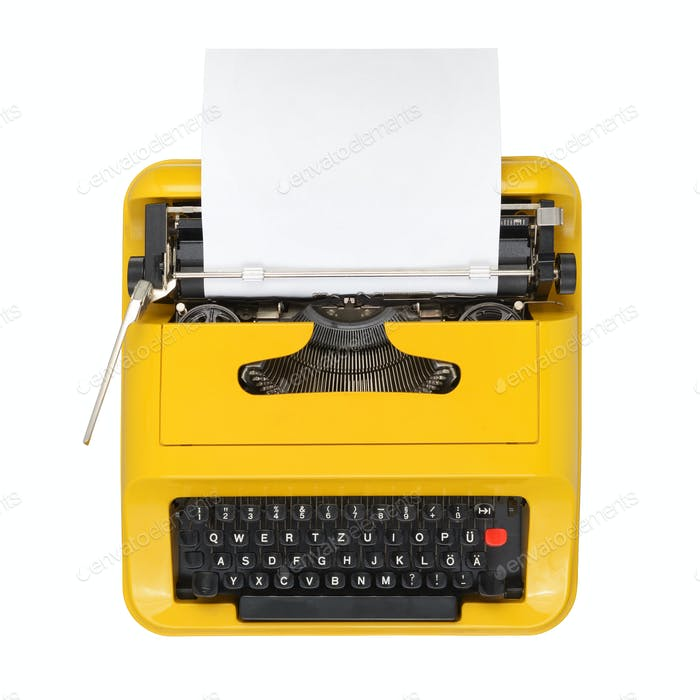 Yellow typewriter solated on white