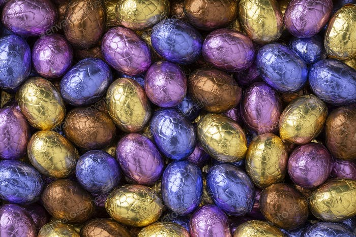 Chocolate easter eggs in colorful tinfoil close up