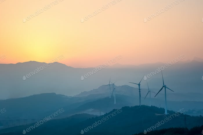 wind farm with distant mountains