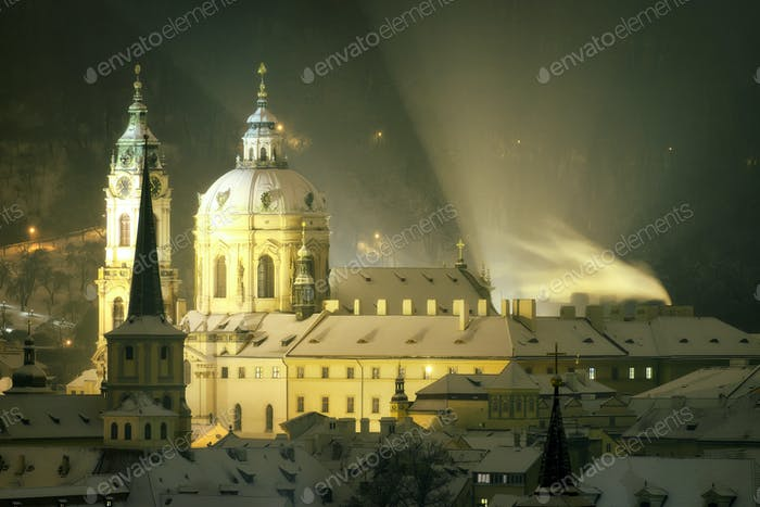 Tower of St. Nicolas church during winter, Prague, Czech republi