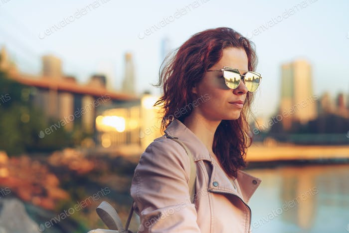 Young girl in sunglasses on the promenade