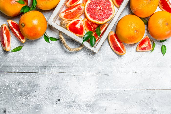 Pieces of ripe grapefruit on a tray.