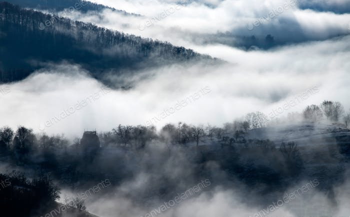 Misty morning in the mountains in autumn.