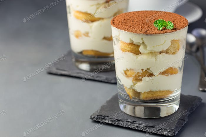 Traditional italian Tiramisu dessert cake in glass, decorated wi