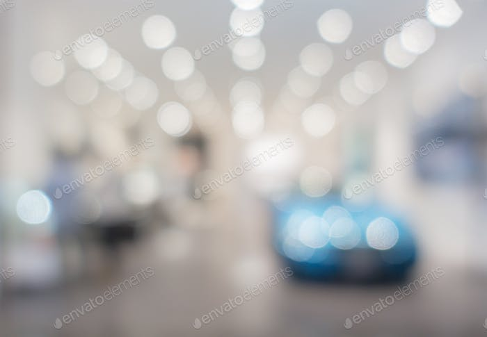 defocused image of car stand in show room