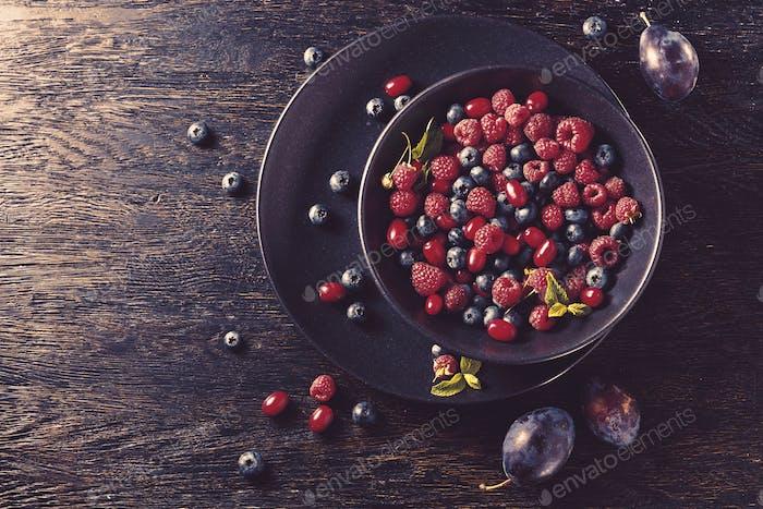 summer fruit on black wooden table