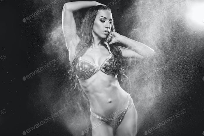 Beautiful girl wearing bikini in rain