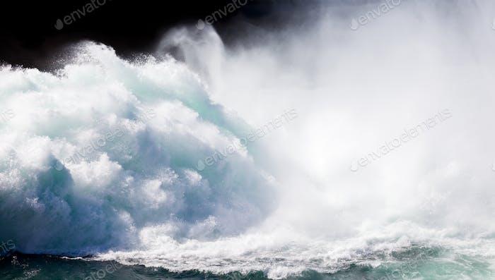 Violent white water turbulent torrent crashing