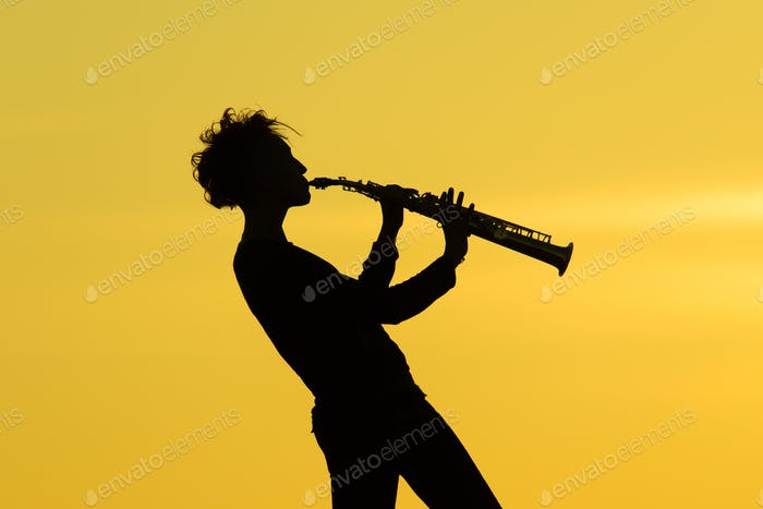 Playing saxophone silhouette