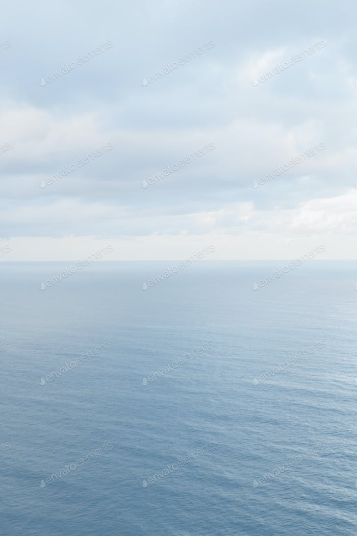 View from the land over the ocean, to the horizon. Open space, seascape and skyscape.