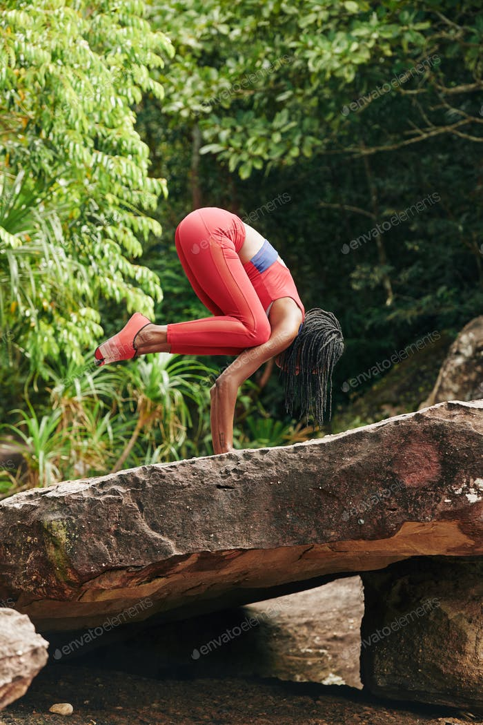 Fit woman practicing handstand