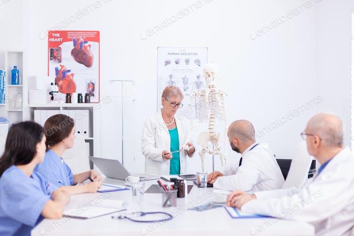 Demonstrating on human skeleton model