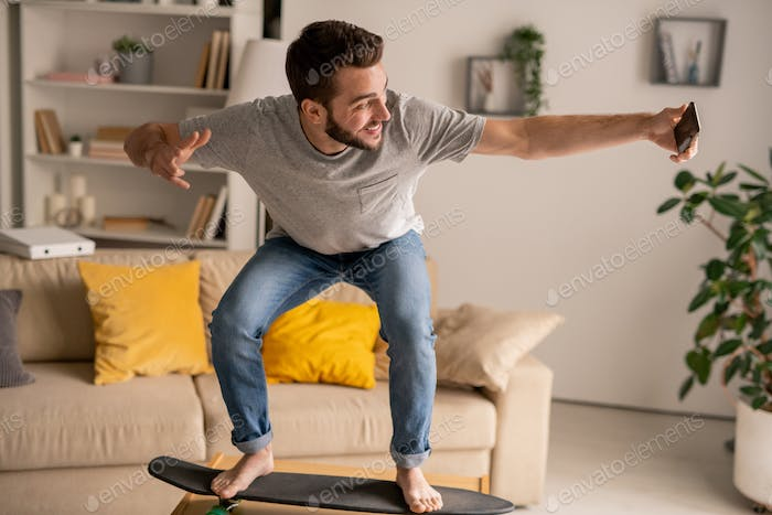Posing on skateboard at home