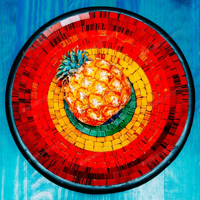 Pineapple on bright background. Mosaic. Tropical style