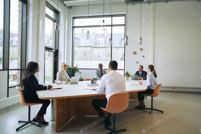 Diverse group of smiling businesspeople having a boardroom meeting