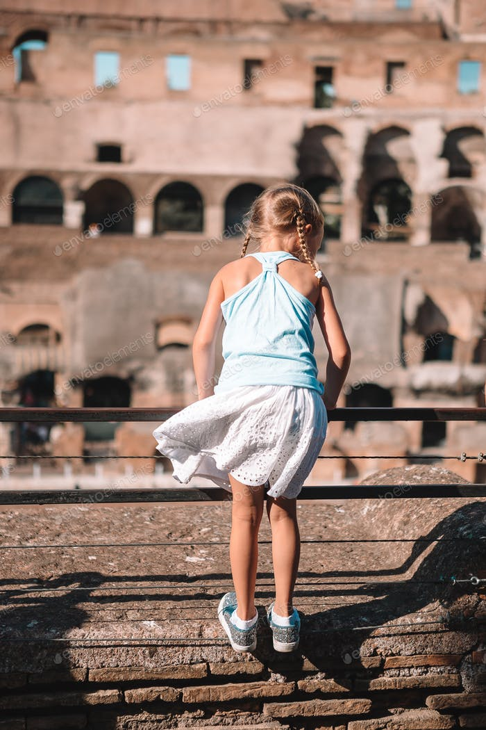 Happy toddler girl in Rome over Coliseum background