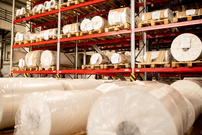 Rows of rolled and packed newly produced huge bobbins of polyethylene membrane