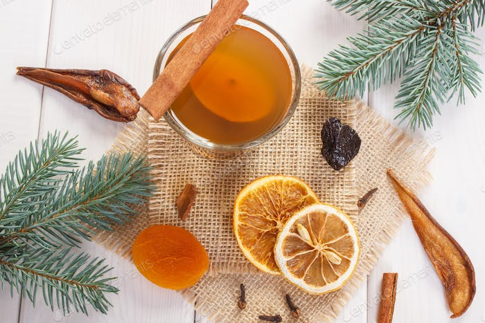 Spruce branches and traditional compote or beverage of dried fruits for Christmas