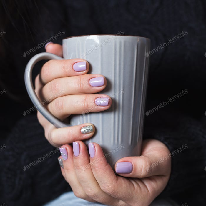 Thumbnail for Woman with beautiful manicure holding a gray cup of tea
