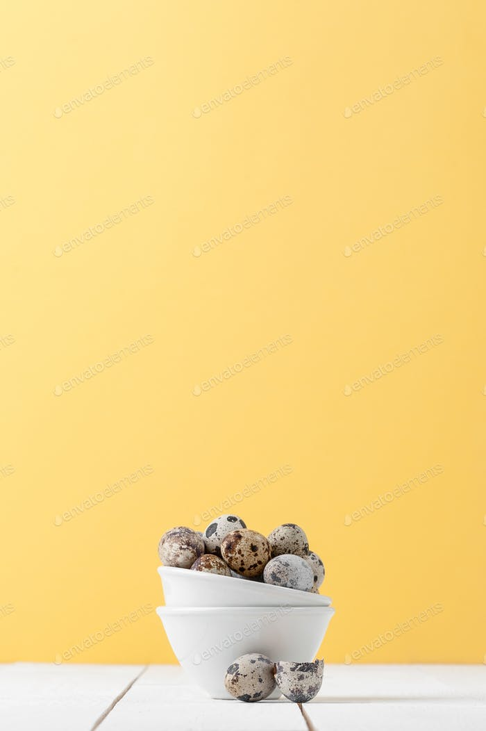 Minimalistic still life: fresh sawed eggs in a miniature white b