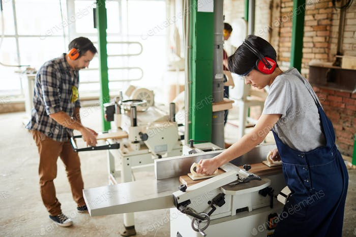 Workers Using Woodworking Machines