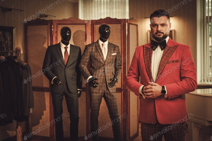 Extravagant stylish man in tailor studio