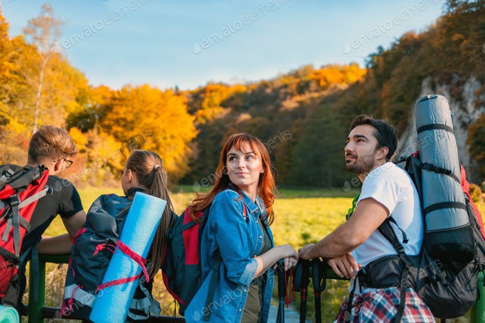 Group of friends during a tourist trip with backpacks