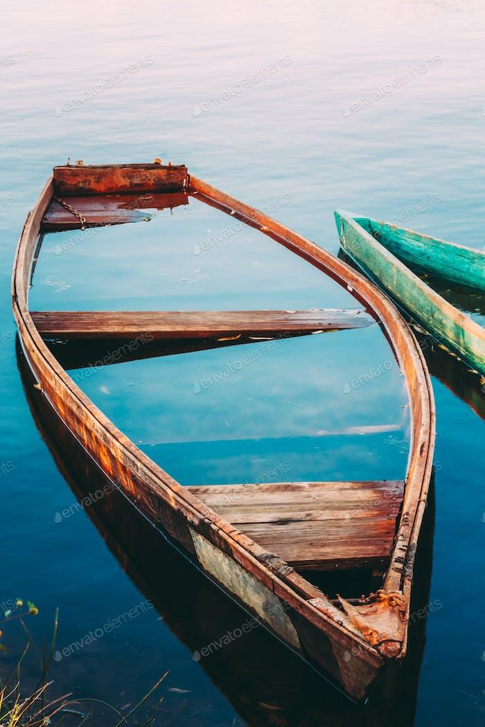 Old Sunken Wooden Fishing Boat In River. Belarusian Nature
