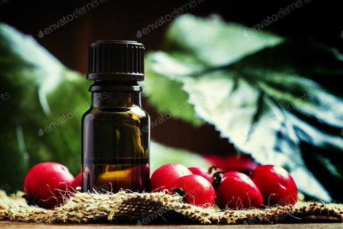 Oil of hawthorn in a brown bottle, selective focus