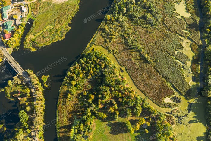 Aerial View Of Town And River Marsh Landscape In Sunny Summer Day. Top View Of Beautiful European