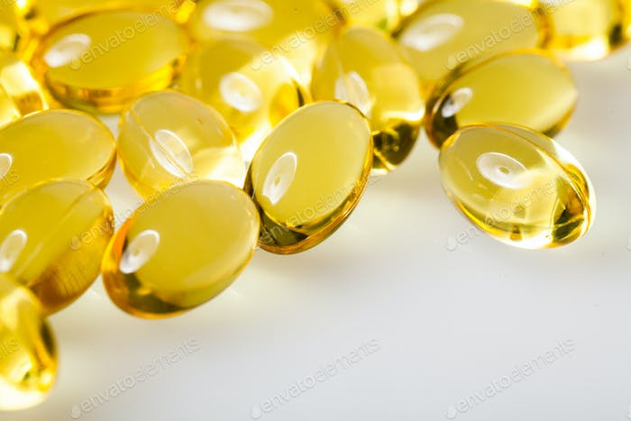 Transparent Vitamins On a White Table